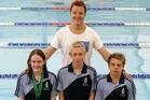 Otumoetai Swim Club members Ruby Matthews (left), Joshua Pickett and Benji Rowe with coach Stefan Swanepoel. Photo/George Novak