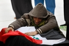 Mohammed Layth Ahmed weeps over the coffin of his father, Layth Ahmed, an Iraqi soldier, in the city of Najaf. Photo / AP