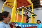 A 7-metre tall colourful chariot is being prepared by Whangarei's Hare Krishna devotees, from left Suvarna Manjari Dasi, Maia Cooper, Vaanipriya Diwan and Buddhi Wilcox, under the chariot, ahead of next week's Ratha Yatra Chariot Festival. Photo / John Stone