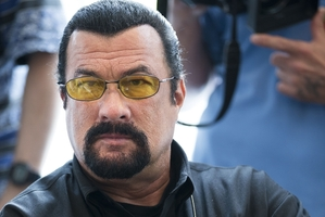 Steven Seagal is considering a shot at Arizona's highest office and has discussed it with Arpaio. Photo / AP