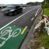 A bike painted white is parked opposite the section of road on Tamaki Drive where 27-year-old Jane Bishop died. Photo / Dean Purcell