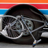 Urgent Couriers cycle courier Dallas Williams' bike underneath the wheels of a bus, after he was knocked off his bike on Albert Street, Auckland in October 2006. Photo / NZ Herald