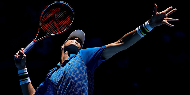At 2.08m tall, John Isner can hit a big serve. Photo / Getty Images.