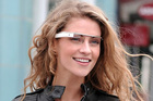 Google Glass projects a virtual computer screen into the field of vision of the wearer.