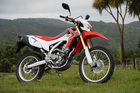 The Honda CRF250L looks like its competition stablemates but lacks their power and is set up for comfort on road and trail. Pictures / Jacqui Madelin