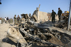 Afghan officials investigate the site of a deadly suicide attack on a joint NATO-Afghan base in the Ghani Khail district of Nangarhar province. Photo / AP
