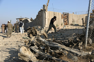 Afghan officials investigate a deadly suicide attack on a joint NATO-Afghan base on January 4. Photo / AP