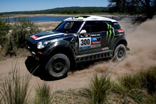 Mini driver Stephane Peterhansel and co-pilot Jean Paul Cottret, both of France, race during the first stage of the Dakar Rally between the cities of Rosario and San Luis, Argentina. Photo / AP