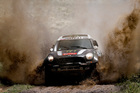Mini driver Stephane Peterhansel and co-pilot Jean Paul Cottret, both of France, race through a creek during the first stage of the Dakar Rally. Photo / AP