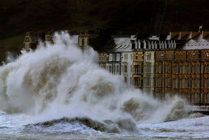Waves crash against the Aberystwyth coastline, in Wales, as strong winds and high tides continue to blow in from the west. Photo / AP