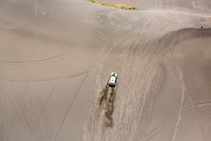 "Mini driver Joan ""Nani"" Roma of Spain and co-pilot Michel Perin of France race up a dune during the second stage of the Dakar Rally between the cities of San Luis and San Rafael. Photo / AP"
