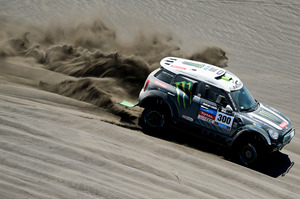 Mini driver Stephane Peterhansel and co-pilot Jean Paul Cottret, both of France, race during the second stage of the Dakar Rally between the cities of San Luis and San Rafael, Argentina. Photo / AP