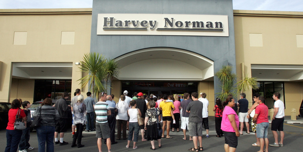 People wait outside of Harvey Norman in Hastings for them to open at 8am on Boxing day. Photo / Glenn Taylor