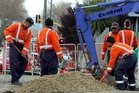 Workers install ultra-fast broadband cables on Cook St in 2011.  Photo/File