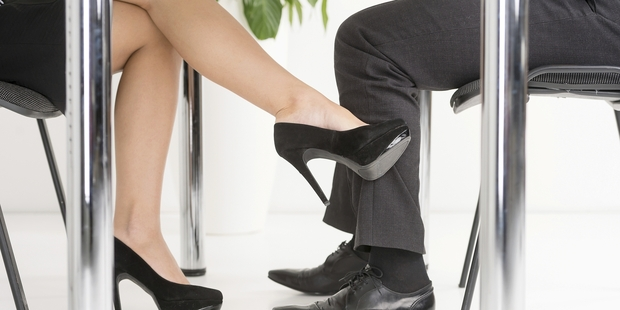 Companies are nervous about how love can upset the workplace. Photo / Getty Images
