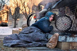 Nick warms himself on a steam grate with three other homeless men just blocks from the Capitol in Washington.