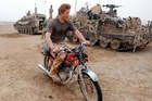 Prince Harry hams it up aboard the abandoned CG 125.