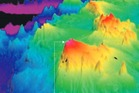 Three-dimensional imaging shows a mountainous ridge with valleys that lie about 2km below the top of its peaks.