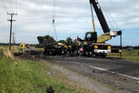 Two large trucks - a B-train and a semi-trailer - and a Nissan vehicle were involved in the crash. Photo / Manawatu Guardian