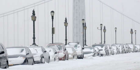 Cars are covered with snow in front of the George Washington Bridge, in the Manhattan borough of New York. Photo / AP