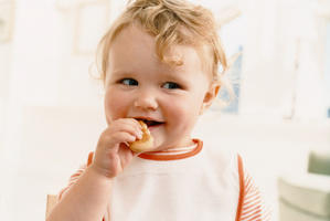 Babies who are allowed to feed themselves are better able to recognise when they are full and are less likely to be fussy eaters. Photo / Thinkstock