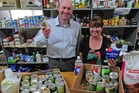 CHEERS: Tauranga Community Foodbank administrator Nicki Goodwin and Bay of Plenty Times editor Scott Inglis celebrated the record $75,000 raised for the charity through this year's Bay of Plenty Times Christmas Appeal.
