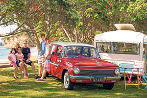 Ashleigh and Andrew Haynes spend their summer holidays with their four children in their two caravans, one of which they tow in their 1963 Holden. Photo / Jason Dorday