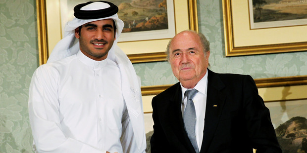 FIFA President Sepp Blatter, right, shakes hands with Sheik Mohammed bin Hamad al-Thani, chairman of Qatar 2022 bid committee. Photo / AP