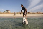 Work may be grinding to a halt on many projects in Gaza but that hasn't stopped people enjoying themselves on Gaza City's beaches. Photo / AP