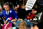 Protesters and SkyCity security clash as they try to storm a lunch at SkyCity hosted by Prime Minister John Key. Photo / Dean Purcell