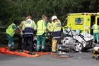 TRAPPED: Emergency crews extract a man from his car at the scene of a three-car crash at Waingawa just before Christmas. PHOTO/FILE