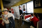 Demonstrators take the protest inside at a McDonald's restaurant in Huntington Park, California, as they press their demands for higher pay and accuse bosses of
