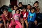 Nelson and Marama Harris with their children (from left) Te Hapuru, 12, Jayson, 10, Dakota, 4, Reiss, 9, Mari, 5, Tytan, 7, and Donna-Maree, 8. Photo / Brett Phibbs
