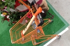 An axe fits tidily in this child's shopping trolley.