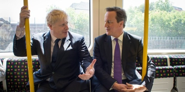 Mayor Boris Johnson and PM David Cameron, seen here campaigning, also joined forces to help a woman who'd collapsed in Harrow. Photo / AFP