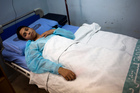Nasser Ayoub, a 16-year-old student, lies on a hospital bed in Damascus, Syria. He was wounded by a mortar fire outside his school. Photo / AP