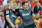 Johnny McNicholl (L) of the Crusaders celebrates with team mates after scoring a try during the round 13 Super Rugby match between the Reds and the Crusaders. Photo / Getty Images.