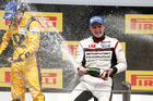 New Zealand's Earl Bamber   on the podium of the Porsche Mobil 1 Supercup in Barcelona. Photo / Supplied