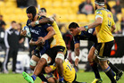 Nasi Manu of the Highlanders is tackled during the round 14 Super Rugby match between the Hurricanes and the Highlanders at Westpac Stadium. Photo / Getty Images.