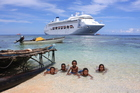 Cruise ship moorings seldom come closer  to shore than the one at Kiriwina Island. Photo / Paul Rush