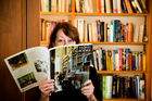 NZ Herald journalist Linda Herrick photographed at home with her library of books. Picture / Babiche Martens