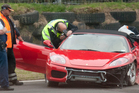 One person is dead after the Ferrari they were driving crashed at Taupo Motorsport Park this afternoon. Photo / Rotorua Daily Post / Ben Fraser