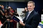 Finance Minister Bill English checking copies of his 2014 Budget. Photo / Mark Mitchell