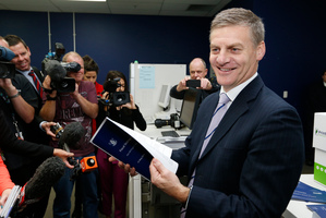 Finance Minister Bill English checking copies of his 2014 Budget as they roll off the press at Printlink in Petone. Photo / Mark Mitchell