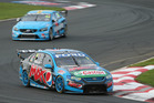 Mark Winterbottom in action at Pukekohe and with his trophy. Pictures / Getty Images