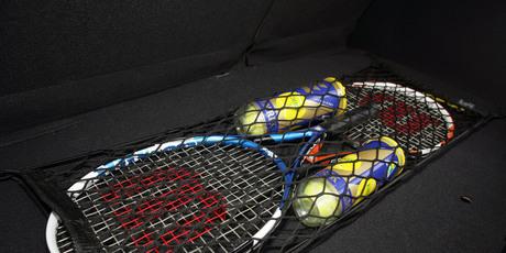 Sports gear stored securely in a cargo net .