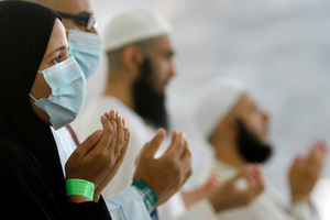 Oct. 2013, file photo of Egyptian Muslim pilgrims, some wearing masks as a precaution against the Middle East respiratory syndrome, praying at the Hajj. Photo / AP