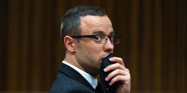 Oscar Pistorius, gestures, as he listens to psychiatric evidence for his defense, during his ongoing murder trial in Pretoria, South Africa. Photo / AP