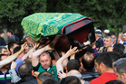 People bear a coffin aloft, of one mine accident victim for burial in Soma, Turkey. Photo / AP