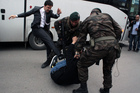 A person identified by Turkish media as Yusuf Yerkel, advisor to Turkish Prime Minister Recep Tayyip Erdogan, kicks a protester already held by special forces. Photos / AP